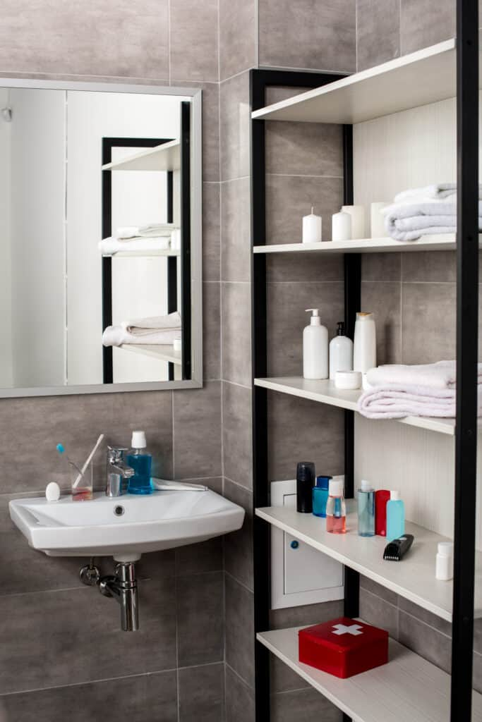 Shelves used to organize a small bathroom.