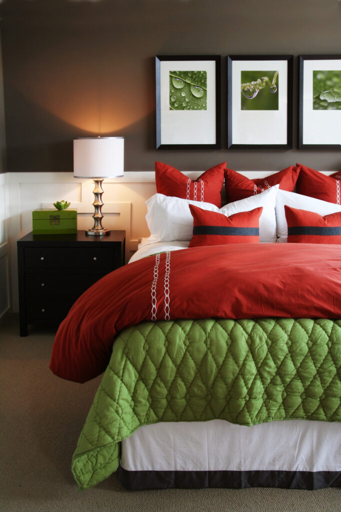 Modern, warm, and inviting bedroom. Using bright colors and beautiful wall art.