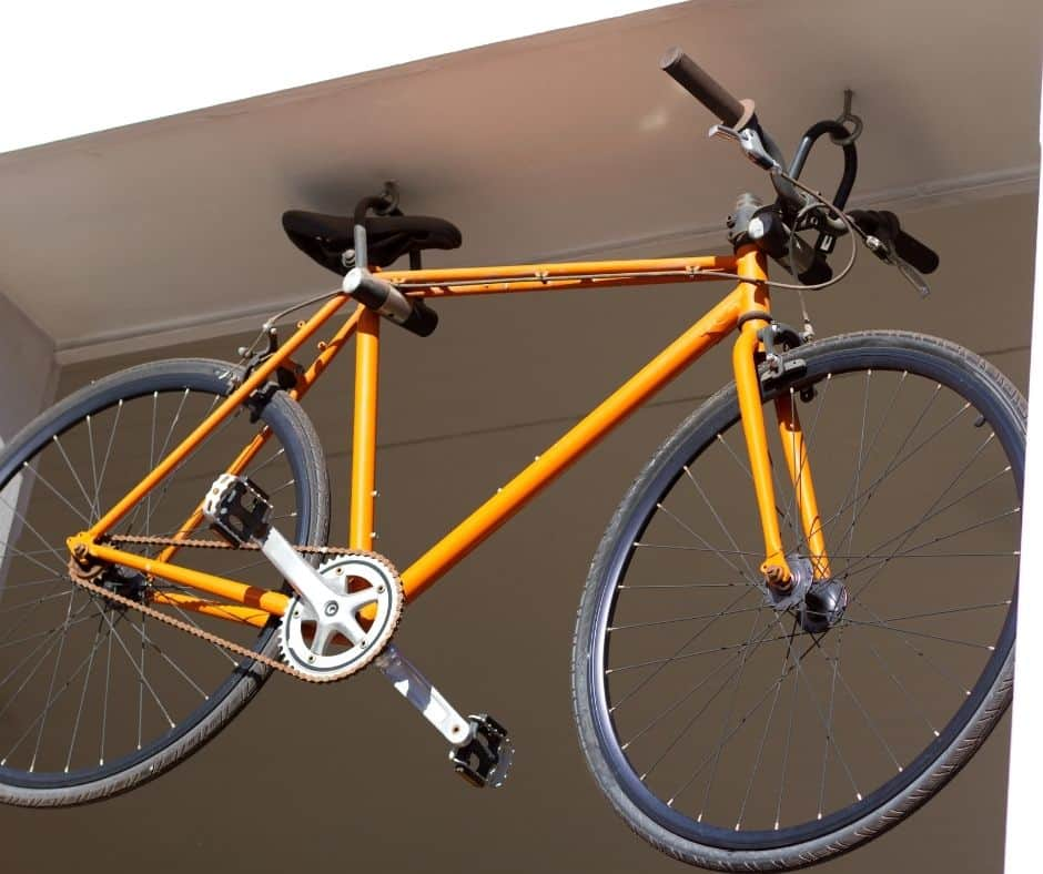 yellow bike hanging from the ceiling