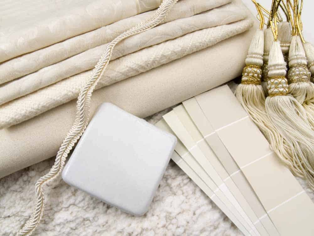 beige and white paint swatches and neutral patterned fabric