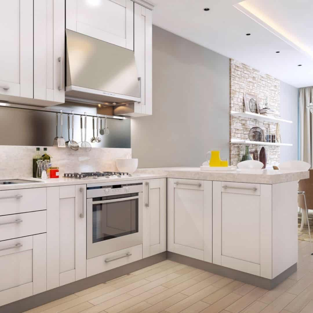 white kitchen with stove and cabinets