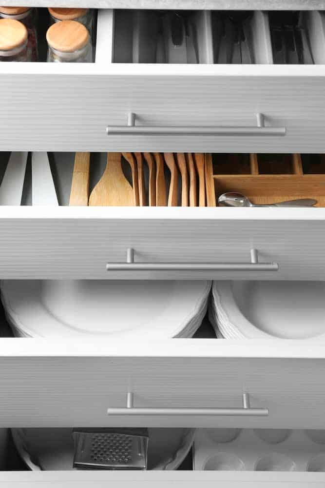 kitchen drawers with utensils and plates and spices
