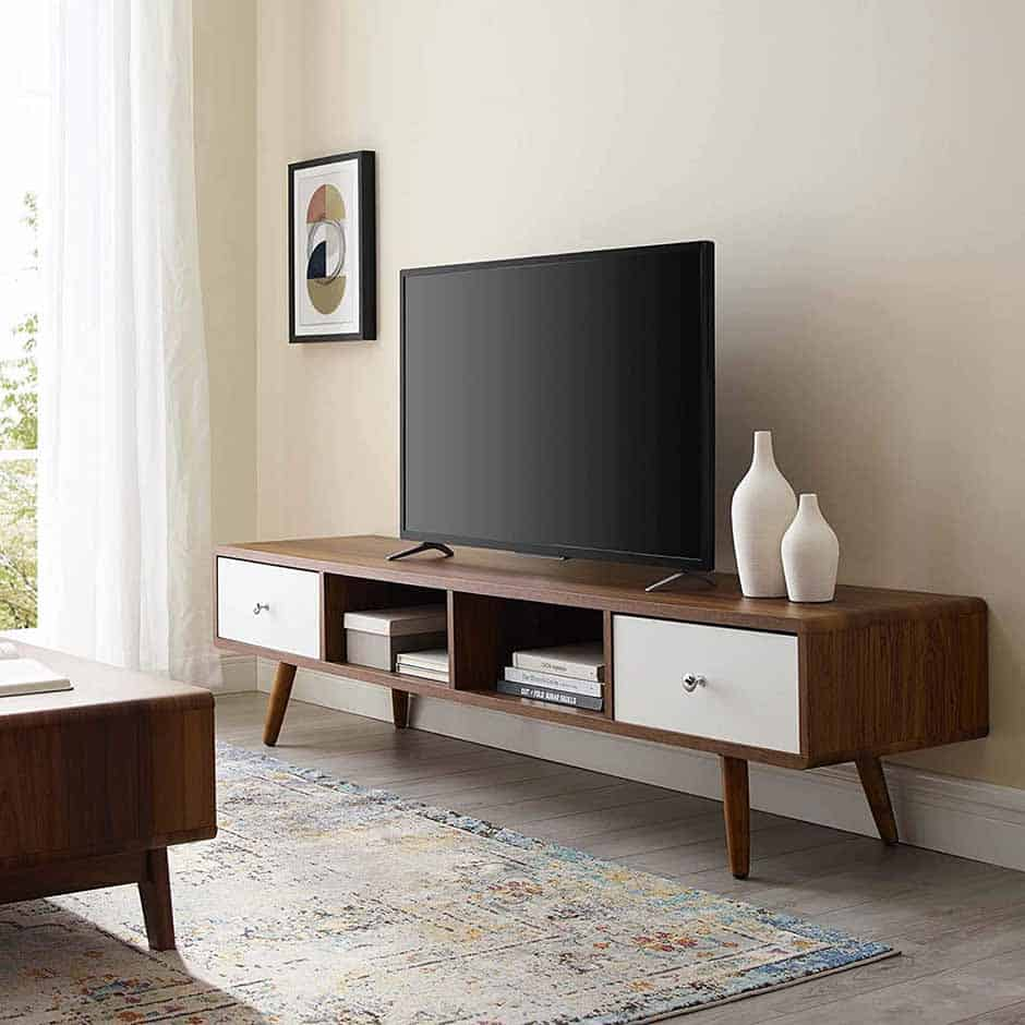 low profile mid century modern tv stand with two doors and two shelving sections in the middle