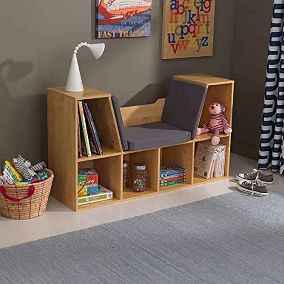 natural wood finish bookcase with built in seating for child's room