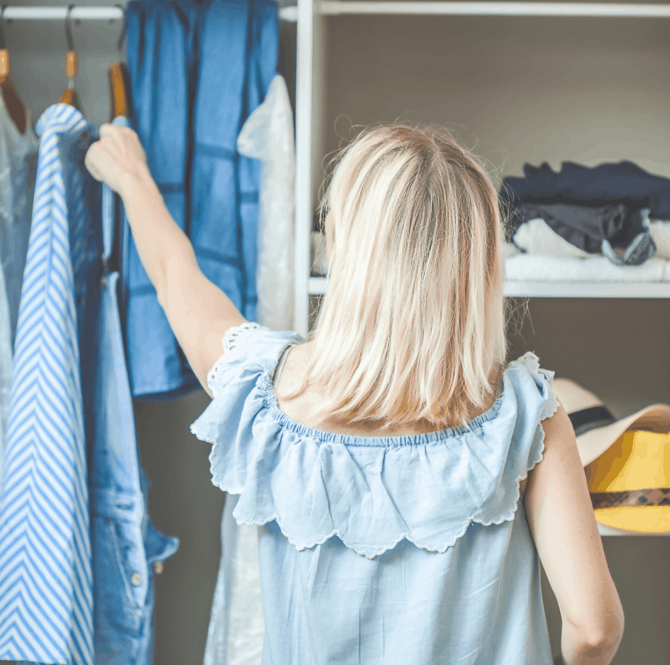 Image of woman decluttering the closet