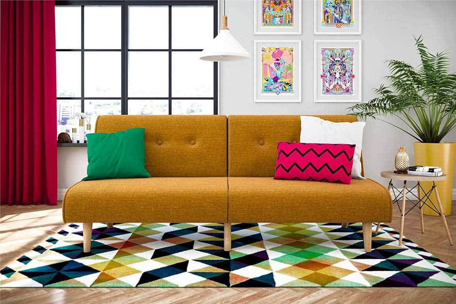 mustard colored mid-century modern sofa with green and red throw pillows